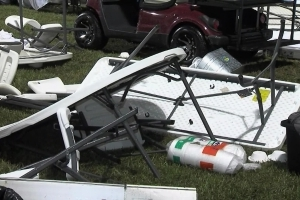 Tent collapse injures 12; speaker Lou Holtz unhurt