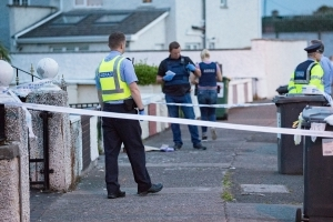 Murder probe launched after man (63) 'slashed in the neck' at his home