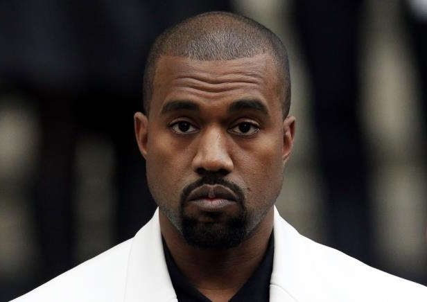 1b9804ae20252 Kanye West wears giant slides after criticism of his  too small  sandals