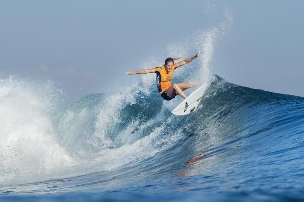 a man riding a wave on a surfboard in the ocean: File Photo
