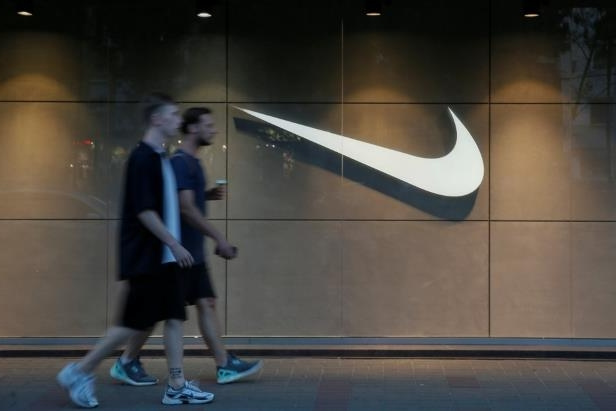 Men walk past a Nike store in central Kiev, Ukraine August 14, 2018. REUTERS/Valentyn Ogirenko