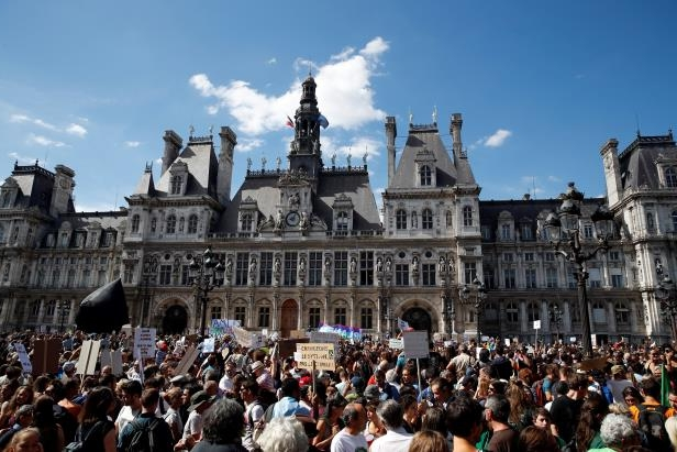 Thousands of people gather in front of Paris town hall during a protest, Saturday, Sept. 8, 2018. Demonstrators in cities across France and Europe were marching on Saturday as part of a global day of protest ahead of a climate action summit this month in San Francisco, California. (AP Photo/Christophe Ena)