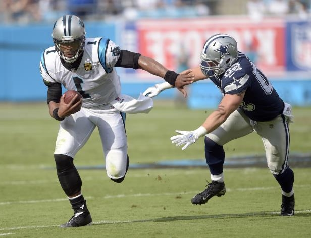 f232c9fd4 Carolina Panthers  Cam Newton (1) runs past Dallas Cowboys  Sean Lee (