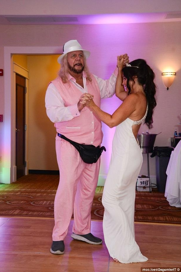a person standing in a room: Pretty in pink: Wendy made sure to make the most of her time on the dance floor and managed to show off a few moves with snazzy-suited retired wrestler Michael Hayes