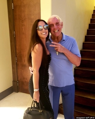 Ric Flair standing posing for the camera: Taking the plunge: Wrestling legend Ric Flair, 68, married longtime fiance Wendy Barlow, 58, at a resort in Florida on Wednesday