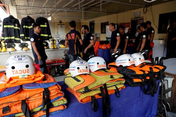 Slide 1 of 9: Rescuers ready their gear before Super Typhoon Mangkhut hits the main island of Luzon, in Muntinlupa, Metro Manila, in Philippines, September 13, 2018.