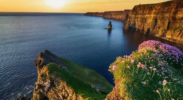 Cliffs of Moher, Ireland: PHOTO: Sunset over the Cliffs of Moher in County Clare along Ireland's Wild Atlantic Way. (photo courtesy of upthebanner / iStock / Getty Images Plus)