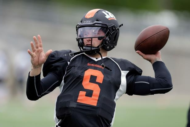FILE - In this April 7, 2018, file photo, former Heisman Trophy-winning quarterback Johnny Manziel (2) prepares for a developmental Spring League football game in Austin, Texas. Manziel is heading to the Canadian Football League, the latest move for the Heisman Trophy winner whose NFL career was a bust with the Cleveland Browns. The quarterback said on Twitter on Saturday, May 19, 2018,  he signed with the Hamilton Tiger-Cats. (AP Photo/Eric Gay, File)