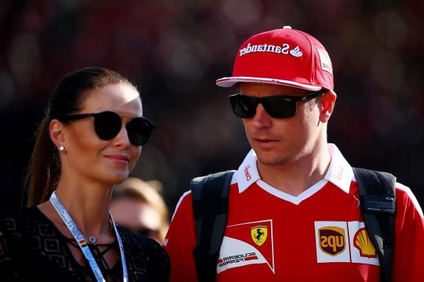 Kimi Raikkonen of Finland and Ferrari talks with wife, Minttu Virtanen, in the Paddock before final practice for the Formula One Grand Prix of Belgium on Aug. 27 in Spa, Belgium.