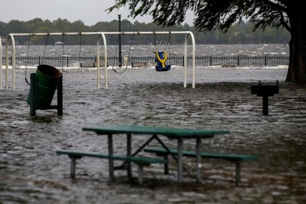 Slide 1 of 62: The Union Point Park Complex is seen flooded as the Hurricane Florence comes ashore in New Bern, North Carolina, U.S., September 13, 2018. REUTERS/Eduardo Munoz