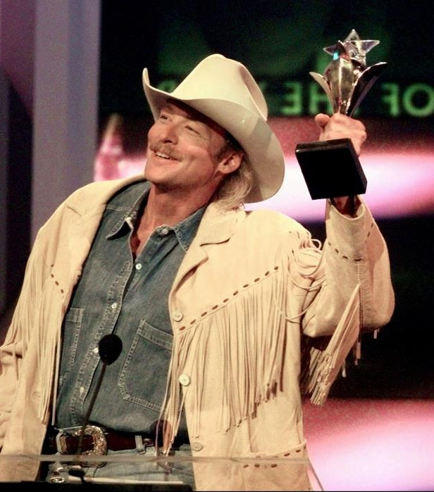 Slide 1 of 65: Alan Jackson accepts his award for Entertainer of the Year during the TNN-Music City News Country Awards show June 16, 1997.