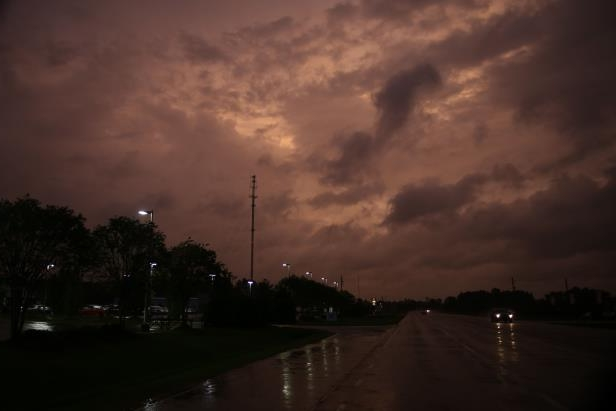 Slide 1 of 71: A deep red sky is seen near New Bern, NC on the evening of the nearby landfall of Hurricane Florence Hurricane Florence, North Carolina, USA - 13 Sep 2018