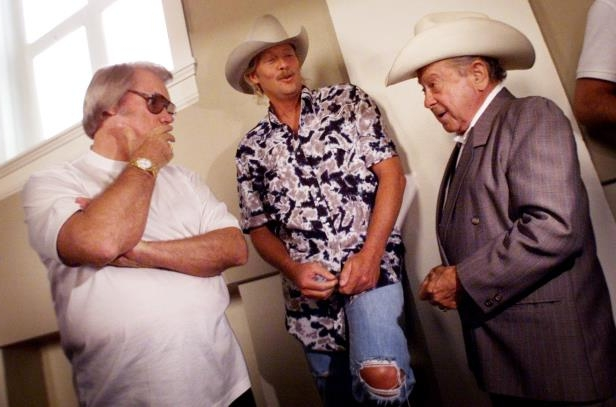 Slide 15 of 65: Little Jimmy Dickens, left, Alan Jackson and George Jones share a moment together at a party to celebrate Alan Jackson selling 35 million albums July 12, 2001.