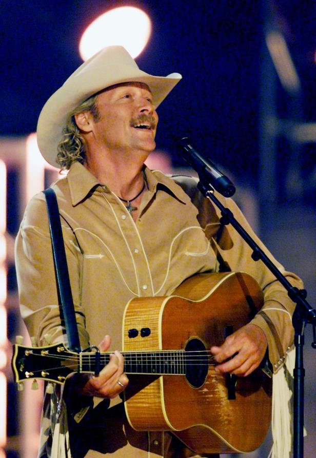 Slide 18 of 65: Alan Jackson performs at the CMT Flameworthy Award Show at the Gaylord Entertainment Center June 12, 2002.