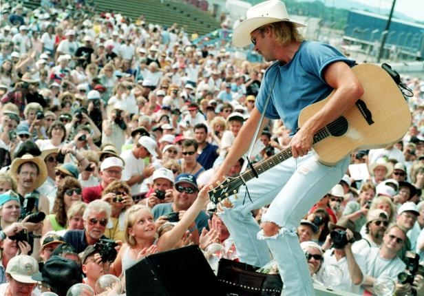 Slide 2 of 65: Alan Jackson interacts with the crowds during his Arista Nashville performance during Fan Fair June 22, 1998 at the State Fairgrounds.
