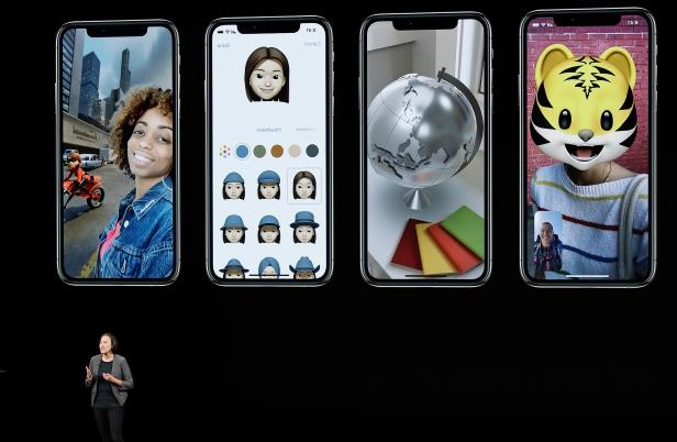 Slide 20 of 44: Kaiann Drance, Apple's senior director, iPhone Worldwide Product Marketing, speaks about the Apple iPhone XS at the Steve Jobs Theater during an event to announce new Apple products Wednesday, Sept. 12, 2018, in Cupertino, Calif.