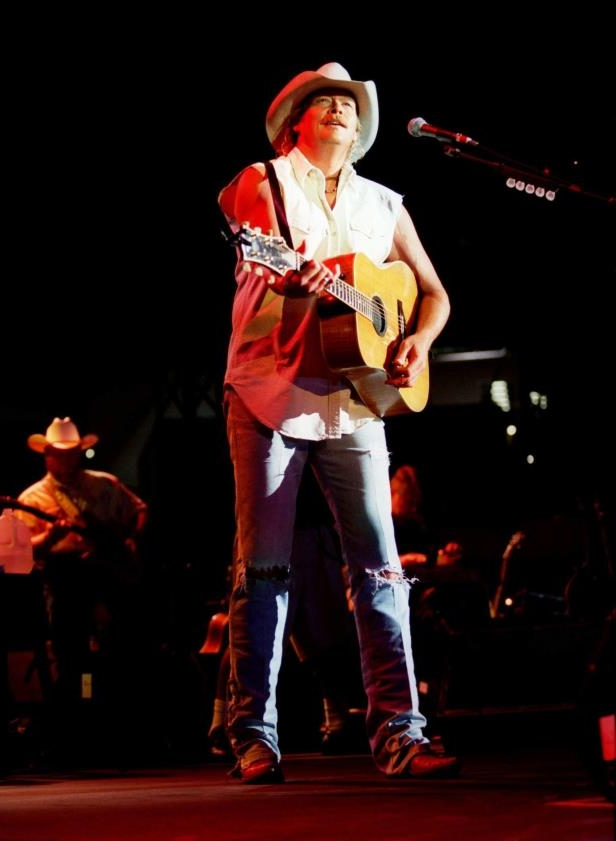 Slide 20 of 65: Alan Jackson performing for the crowd during the RCA Label Show during Fan Fair at Adelphia Coliseum June 13, 2002.