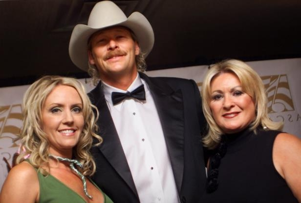 Slide 21 of 65: Alan Jackson, center, with Connie Bradley, left, ASCAP Senior Vice President, and his wife Denise share a moment during the ASCAP Awards dinner Nov. 4, 2002. Jackson was honored with the career achievement Golden Note Award and Songwriter/Artist of the Year award.