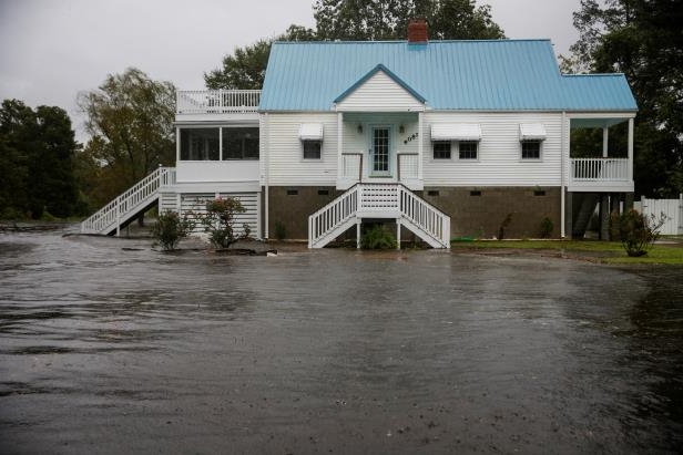 Slide 21 of 71: Water from Neuse River floods houses as Hurricane Florence comes ashore in New Bern, North Carolina, U.S., September 13, 2018. REUTERS/Eduardo Munoz