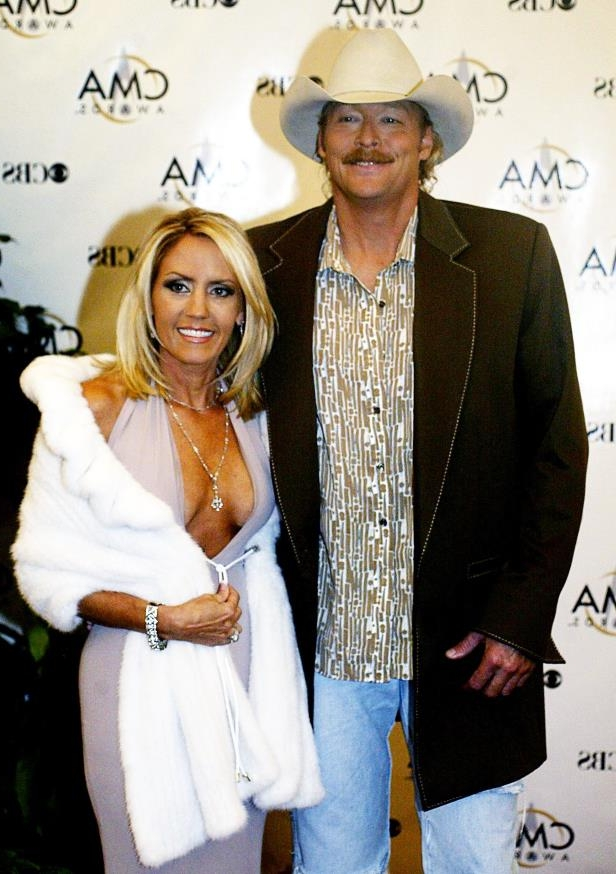 Slide 25 of 65: Alan Jackson and wife Denise arrive at the 37th annual CMA Awards show Nov. 5, 2003.