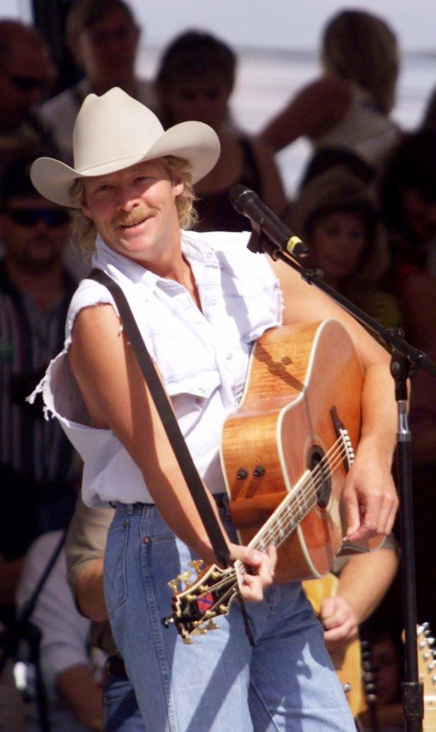 Slide 3 of 65: Alan Jackson performs for the crowd during Fan Fair June 17, 1999 at the State Fairgrounds.
