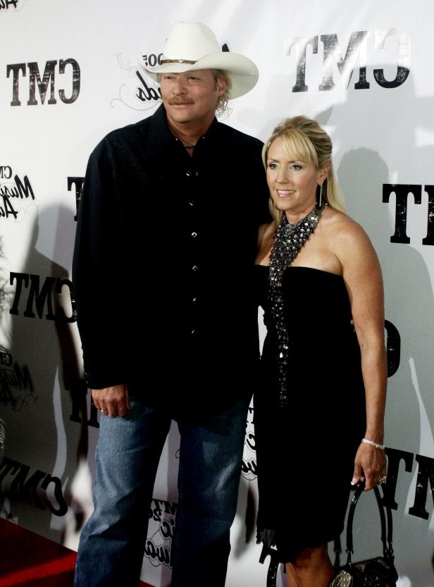 Slide 30 of 65: Alan Jackson and his wife Denise are on the red carpet before the CMT Music Awards show at the GEC March 10, 2005.