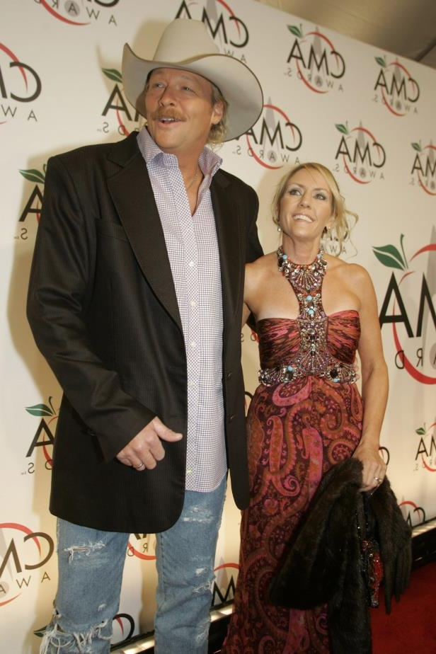 Slide 33 of 65: Alan Jackson and his wife Denise are on the red carpet prior to the CMA Awards show at Madison Square Garden in New York Nov. 15, 2005.