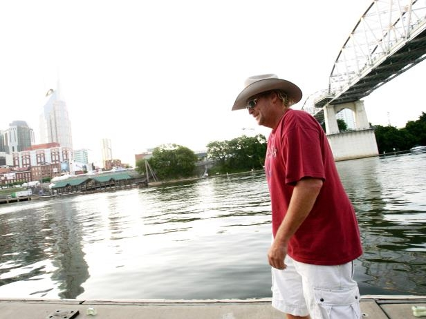 Slide 35 of 65: Alan Jackson arrives via his antique yacht to the CMA Music Festival at LP Field June 7, 2008.