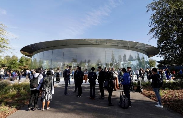 Slide 4 of 44: People stand outside of the Steve Jobs Theater before an event to announce new Apple products Wednesday, Sept. 12, 2018, in Cupertino, Calif.