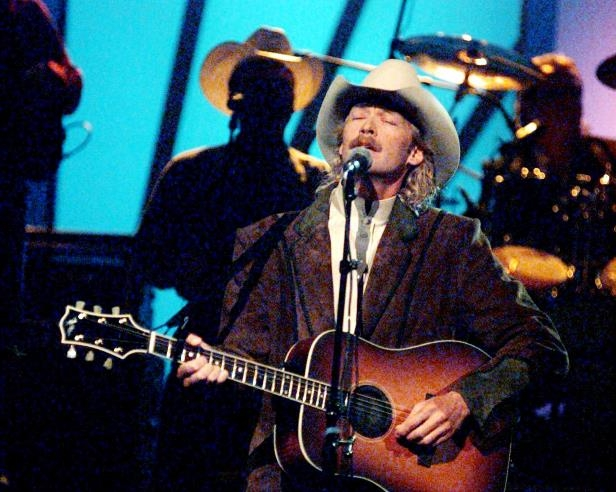 Slide 4 of 65: Alan Jackson performs one of his hits during the 30th annual CMA Awards show at the Grand Ole Opry House Oct. 2, 1996.