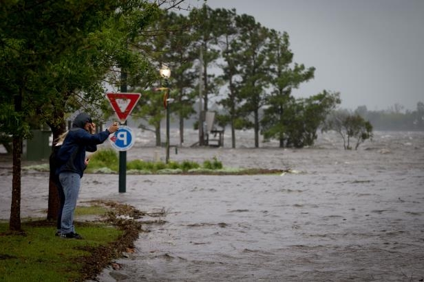 Slide 4 of 71: Major flooding is seen nearly sixteen hours before the landfall of Hurricane Florence, as early storm surges caused the Neuse River to rise above its' banks and into downtown New Bern, NC Hurricane Florence, North Carolina, USA - 13 Sep 2018
