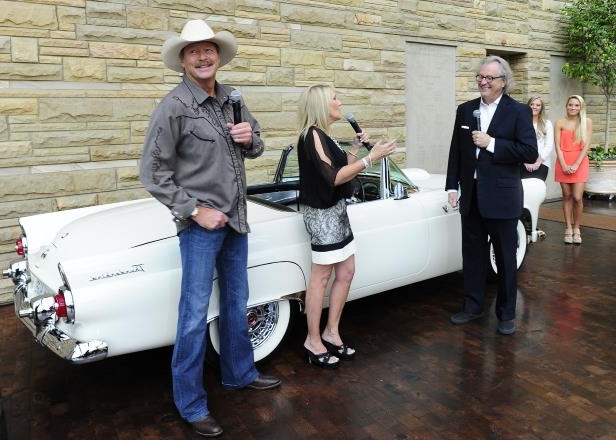 Slide 56 of 65: Country Music Hall of Fame and Museum director Kyle Young, left, ask a question to Alan Jackson and his wife Denise about Jackson's first car, a 1955 Ford Thunderbird which was on display during an opening party for Alan Jackson's exhibit in commemoration of his 25 years in country music Aug. 27, 2014.