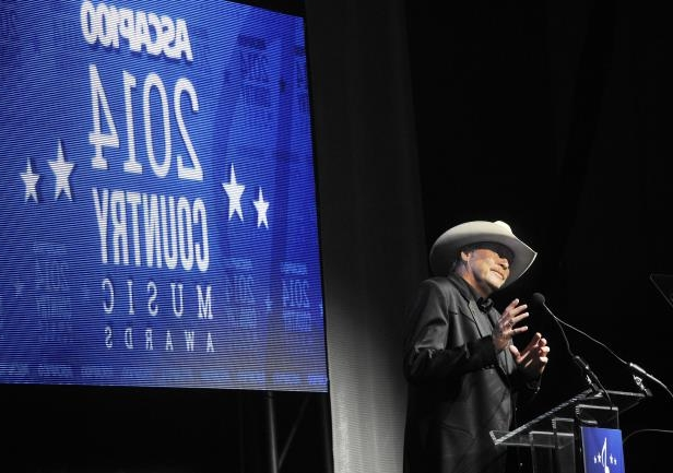 Slide 58 of 65: Alan Jackson accepts the Heritage Award during the 52nd annual ASCAP Country Music Awards show and dinner Nov. 3, 2014.
