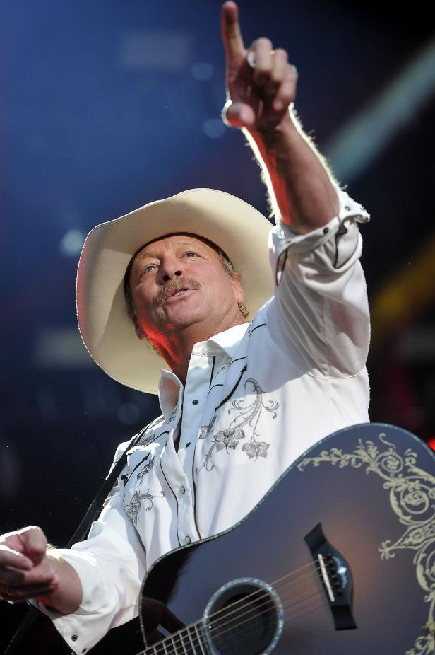 Slide 63 of 65: Alan Jackson performs onstage during the CMA Music Festival at LP Field June 11, 2015.