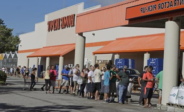Slide 63 of 71: People line up outside a Home Depot for a new supply of generators and plywood in advance of Hurricane Florence in Wilmington, N.C., Wednesday, Sept. 12, 2018. Florence exploded into a potentially catastrophic hurricane Monday as it closed in on North and South Carolina, carrying winds up to 140 mph (220 kph) and water that could wreak havoc over a wide stretch of the eastern United States later this week.