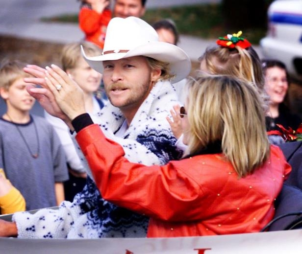Slide 7 of 65: Alan Jackson, and family, smiles at the crowd as they make their way through Franklin during the annual Franklin Christmas Parade Dec. 4, 1999. Jackson was the Grand Marshall.