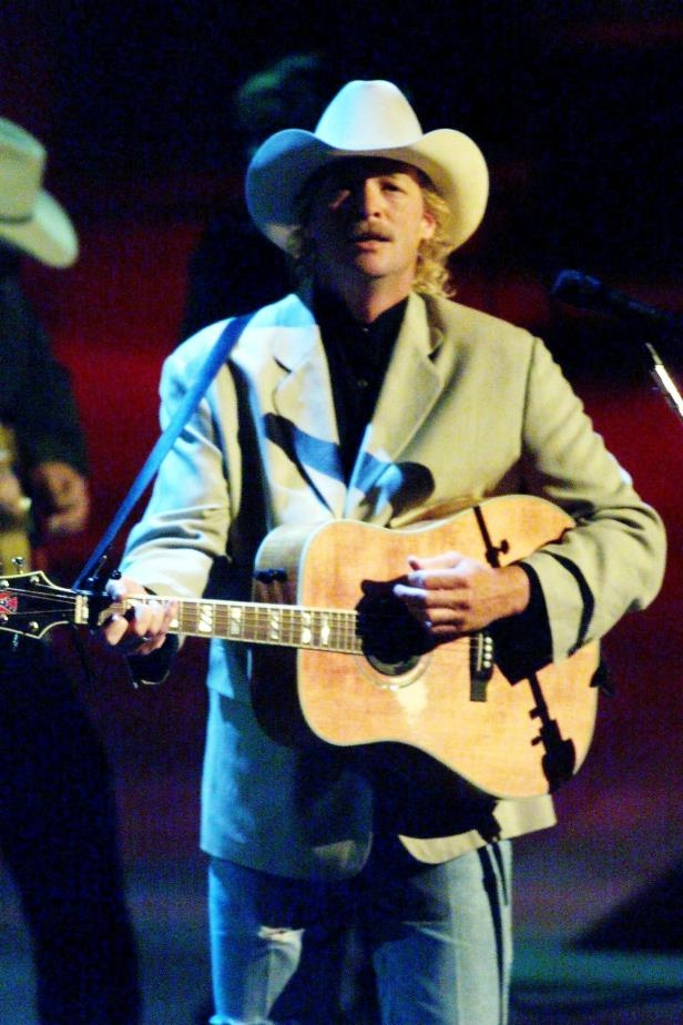 Slide 8 of 65: Alan Jackson performs during the TNN Music City Awards show at the Nashville Arena June 22, 1999.