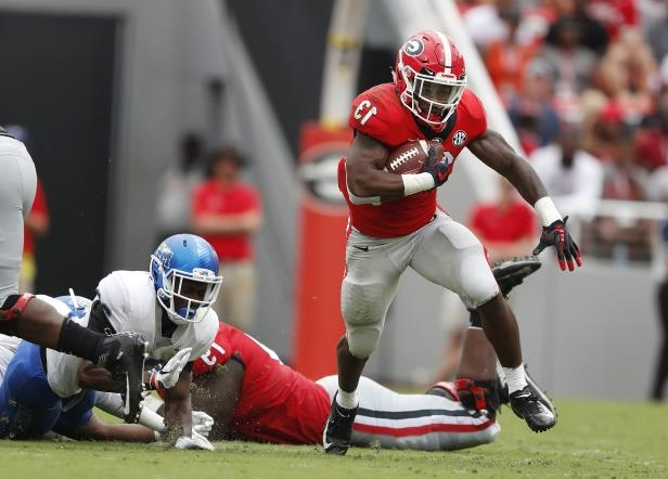 a5004818920 Georgia running back Elijah Holyfield (13) breaks through the Middle  Tennessee defense for a