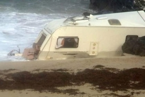 Woman dies after storm blows caravan off cliff in Ireland