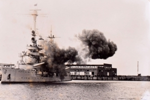 The shots that sparked WWII: Chilling photos reveal moment Nazi battleship pounded a Polish harbour... and set the world at war again, leading to 70m dead