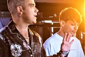633720f4f The X Factor: Robbie Williams and Louis Tomlinson give each other 'X'  tattoos