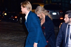 Taylor Swift steps out in a sheer dress for rare public outing with boyfriend Joe Alwyn