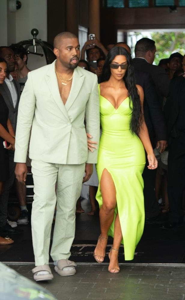 418aef369f8a a group of people posing for the camera  Kim Kardashian West and Kanye West  attend