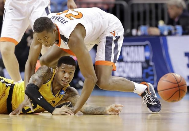 Slide 70 of 101  UMBC s Jairus Lyles (10) passes the ball as Virginia s a3f3b0230