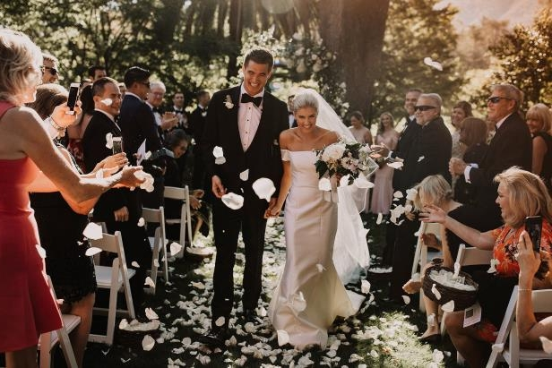 "Slide 7 of 77: Going for romance gold! In late September, Olympian Adrian married his longtime love Ivester. In a romantic outdoor ceremony planned by Lally Events, the couple said ""I do"" surrounded by their friends and family in Napa Valley, California."