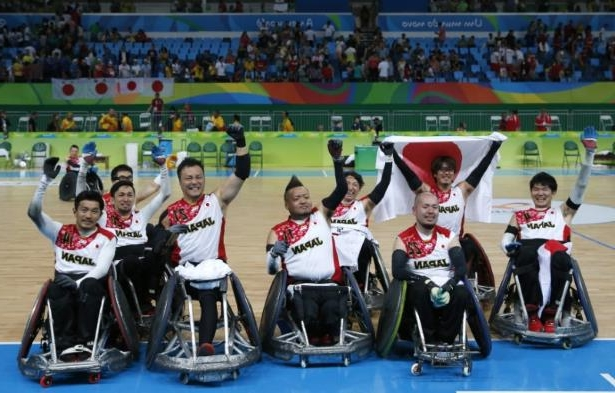 a group of people around each other: FILE PHOTO: Football Soccer - Wheelchair Rugby - Final - Mixed Team Bronze Medal Final - Japan v Canada