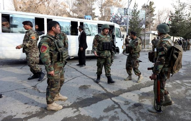 Afghan soldiers inspect the site of attack on a military hospital in Kabul, Afghanistan, Wednesday, March 8, 2017. Afghanistan's Defense Ministry says an attack on a military hospital in the capital has killed more than 30 people. (AP Photo/Rahmat Gul)