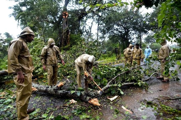 At least two men have died in Cyclone Titli, one when a house collapsed and another killed by a falling tree