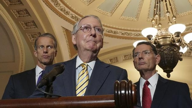 Mitch McConnell wearing a suit and tie: GOP loads up lame-duck agenda as House control teeters