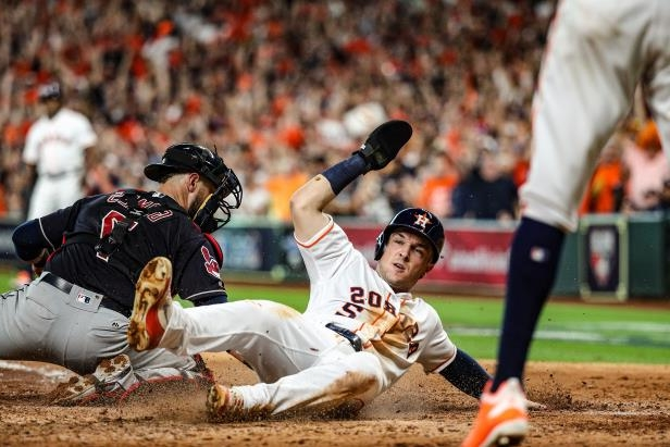 Slide 23 of 47: HOUSTON, TX - OCTOBER 6:  Alex Bregman #2 scores on a double hit by Marwin Gonzalez #9 (not pictured) of the Houston Astros in the sixth inning during Game 2 of the ALDS against the Cleveland Indians at Minute Maid Park on Saturday, October 6, 2018 in Houston Texas.